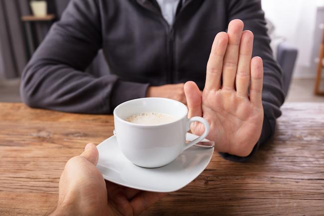 man refusing coffee
