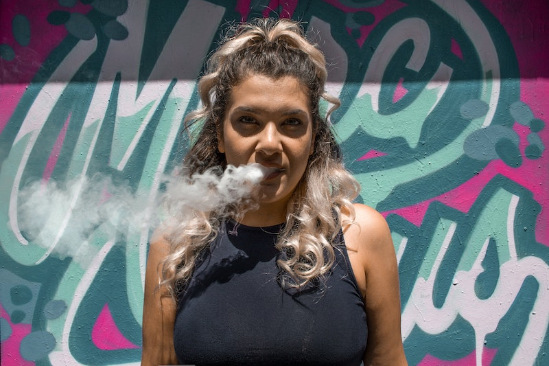 woman smoking vape