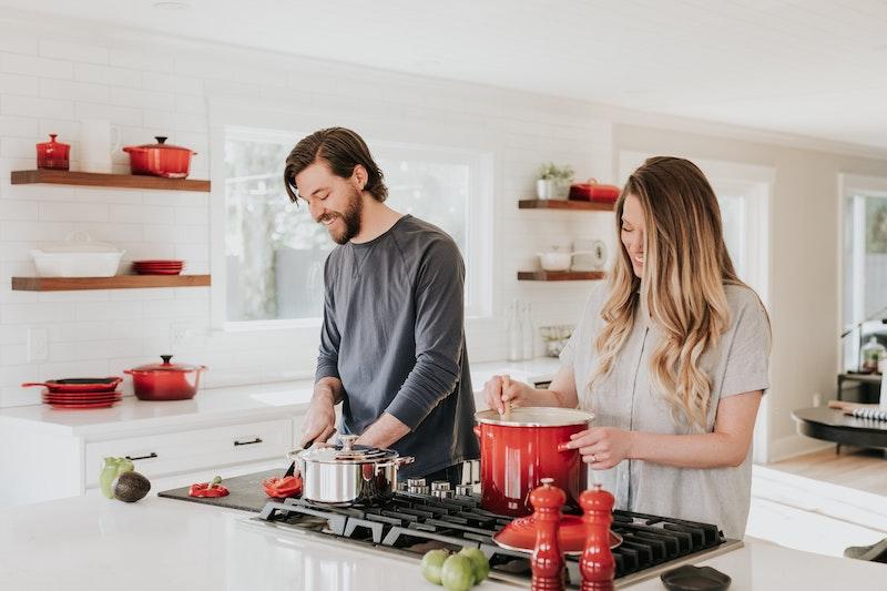man and woman kitchen