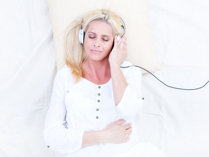 woman relaxing headphone on hypnosis